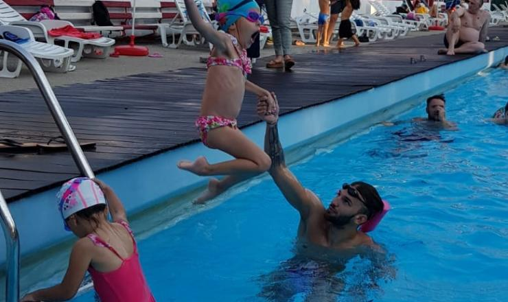 Outdoor pool, sun and cheerful children